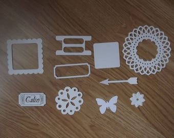 Set of 10 white embellishments for scrapbooking.