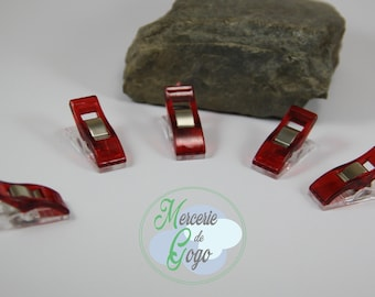 "Set of 5 red ""CLOVER"" type clips."