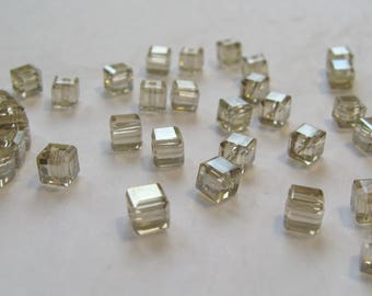 Set of 10 cubes, 4 mm Crystal beads.