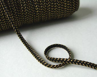 Stripe, 4 mm, black and gold, sold by the yard.