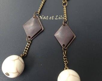 White magnesite on bronze diamond pendant