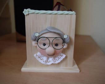 Put glasses or remote control version Grandma
