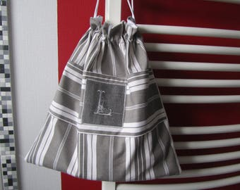 Gray and white ticking laundry bag