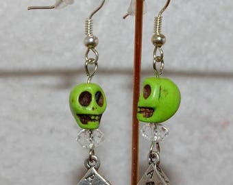 Skulls skull earring and these cards