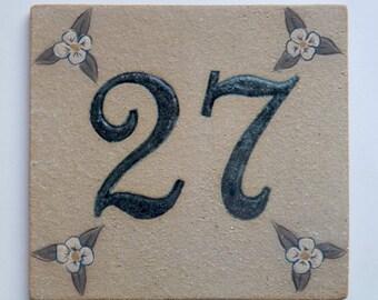 Ceramic door number ochre '27' and decorative flower