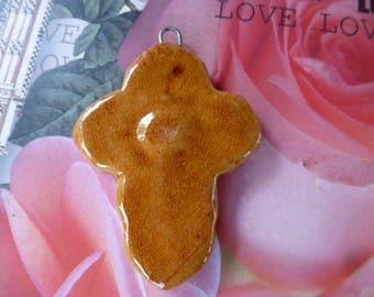 hand made caramel colored glazed ceramic cross pendant