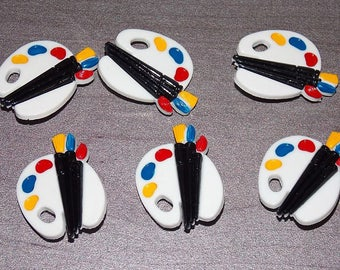Buttons plastic with paint palette shaped foot