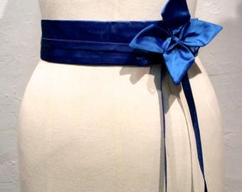 High waisted blue silk belt.