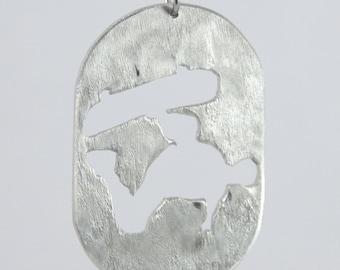 Skateboard pendant aluminum on stainless steel chain.