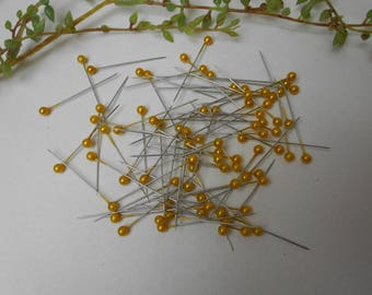 80 pins with yellow beads
