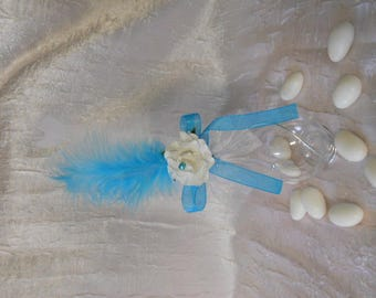 Water drop made of plexiglass with aluminum wire and white flower and turquoise feathers for wedding
