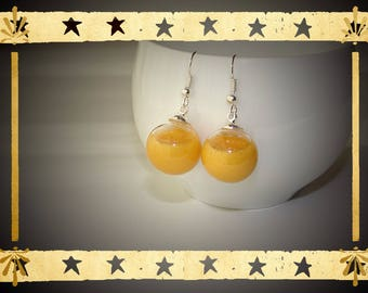 Gold color opaque liquid filled glass globe mounted on Stud Earrings