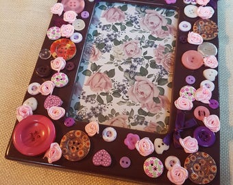 Embellished photo frame.