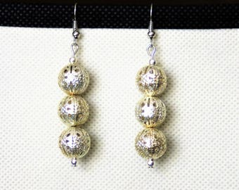 Earrings with openwork silver metal beads