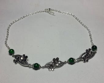 Bouquet of flowers, green beads necklace