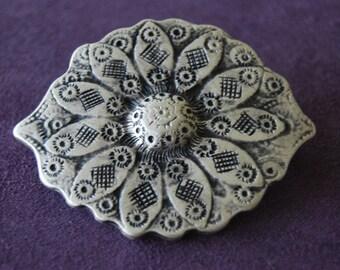 Delicate decorative piece, metal, silver color.