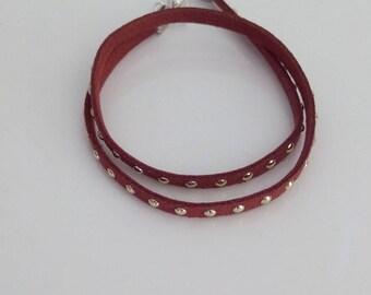 Brown studded cross bracelet