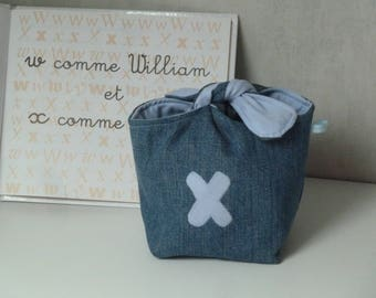 Knotted vintage, X, recycled denim pouch inside blue shirt