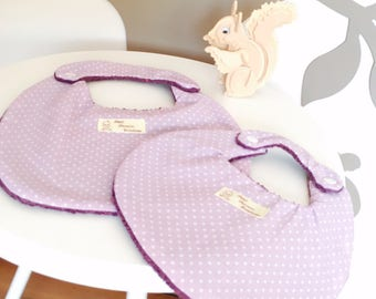 SET of two BIBS has DOUBLE opening purple and purple