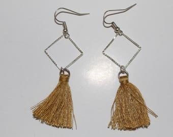 Pair of beige/taupe tassel earrings