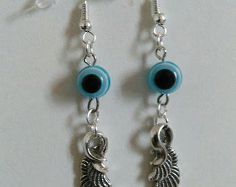 Earrings light blue silver wing with pearls.
