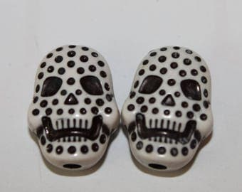 Skull double-sided, white, 15 * 20 mm, the pair