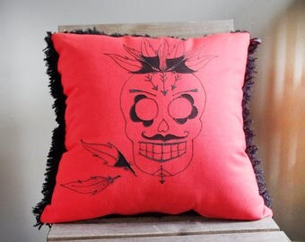 Flashy red and black skull pillow