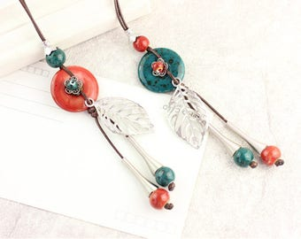 A nice ethnic necklace with ceramic and charm