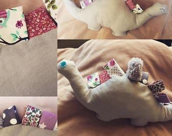 Plush Dino tag while fabrics...