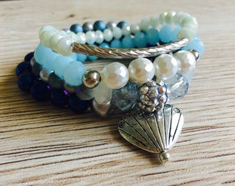 Bracelet set with a pewter heart .