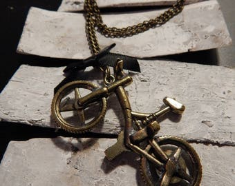 Necklace bronze metal bicycle and black bow
