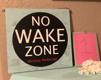 No wake zone / seas & greetings reversible sign