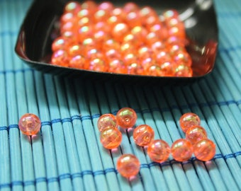 Round 6 mm orange/coral plastic beads