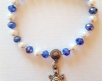 Bracelet blue white and turtle beads