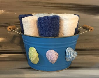 Blue Bathroom Bin - Bathroom Wash Cloth BIn with Wooden Handles and Seashells. 4 dark blue, 4 light blue and 4 white wash cloths.