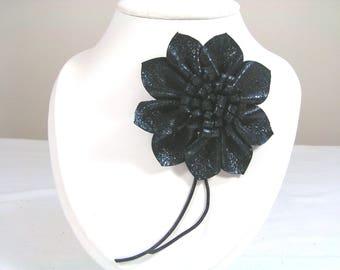 Brooch black lambskin leather understated, elegant flower
