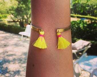 Brass bracelet with two-tone tassels