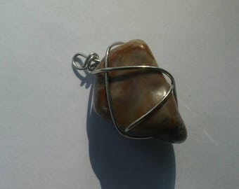 Brown marbled wire wrapped stone pendant on cord