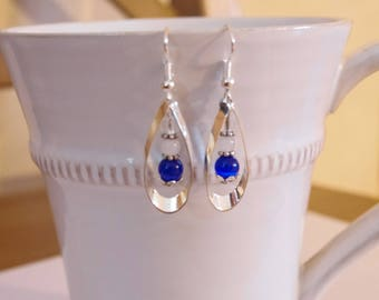 Drop earrings dangling silver and blue color