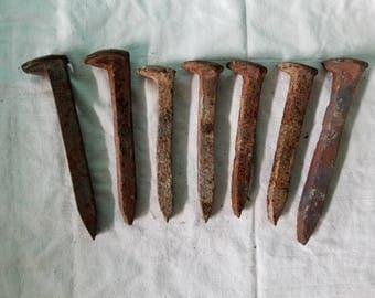 Seven railroad spikes, four vintage