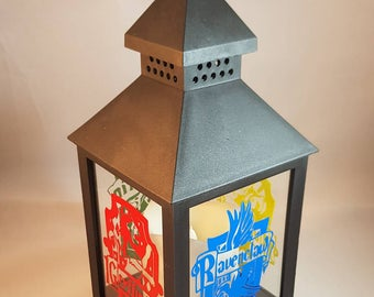 Harry Potter house crest lantern . Gryffindor, slytherin, hufflepuff and ravenclaw .