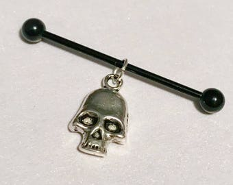 Silver metal skull charm on 14g silver or black anodized stainless steel industrial barbell body jewelry
