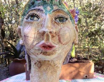 Head sculpture, the green Queen