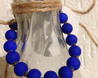 Neon blue beads bracelet of glass beads