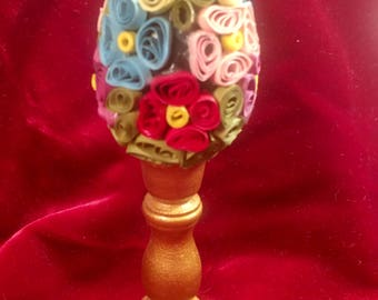 Quilled egg on  wooden stand