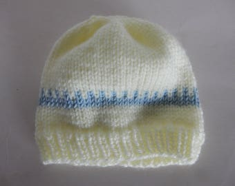 Knitted yellow baby hat