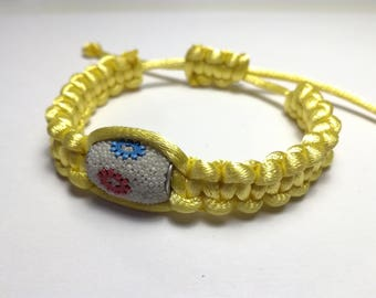 Yellow satin with long pearl bracelet