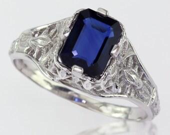Blue Sapphire set on 14k White Gold Filigree Ring.