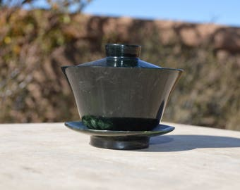 Small jade tea cup on saucer with lid