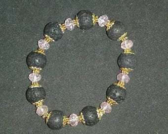 Black, pink, and gold stretch bracelet